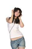 Mooi meisje met hoofdtelefoons Royalty-vrije Stock Foto's
