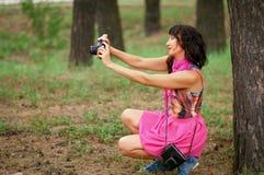 Mooi meisje met hoofdtelefoons Stock Foto's