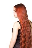 Mooi meisje met lang rood culry haar Stock Afbeelding