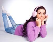 Mooi meisje met oorbeschermer Stock Foto
