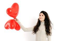 Mooi meisje met rode ballons Stock Afbeelding