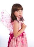 Mooi meisje met roze in hand royalty-vrije stock afbeeldingen