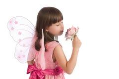 Mooi meisje met roze in hand stock fotografie