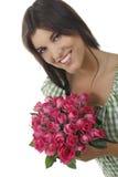 Mooi meisje met rozen Stock Foto's