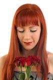 Mooi meisje met rozen Stock Afbeeldingen