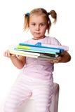 Mooi meisje met stapel van boeken Stock Afbeeldingen