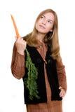 Mooi meisje met wortel Stock Afbeeldingen