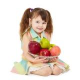 Mooi meisje op wit met plaat van fruit Stock Foto