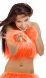 Mooi meisje in oranje kostuum Stock Afbeelding
