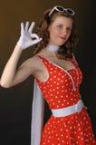 Mooi meisje in rode kleding. Royalty-vrije Stock Foto