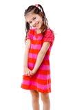 Mooi meisje in roze kleding Royalty-vrije Stock Afbeeldingen