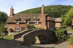 Mooi plattelandshuisje in Allerford, Exmoor, het UK Stock Foto