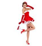 Mooi sexy meisje dat de kleren van de Kerstman draagt stock foto