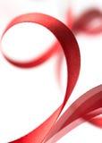 Mooi stoffen rood lint op wit Stock Foto's