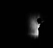 Mooi vrouwensilhouet, zwarte achtergrond Royalty-vrije Stock Foto's