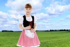 Mooi weinig blondemeisje met lang haar en korte klappen  Stock Afbeelding