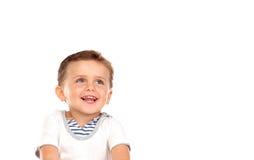 Mooi weinig kind met een mooie glimlach die omhoog eruit zien Royalty-vrije Stock Afbeelding