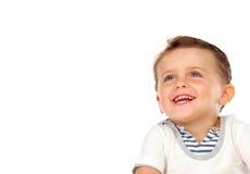 Mooi weinig kind met een mooie glimlach die omhoog eruit zien Stock Foto's