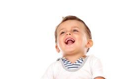 Mooi weinig kind met een mooie glimlach die omhoog eruit zien Royalty-vrije Stock Foto's