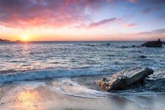 Mooi zonsondergangstrand stock foto's