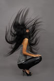 Mooie Aziatische vrouw in gestript vest stock foto's