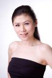 Mooie Aziatische vrouwenglimlach stock afbeeldingen