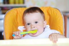 Mooie baby met lepel Royalty-vrije Stock Foto