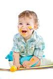 Mooie baby omvat in heldere verf Royalty-vrije Stock Afbeeldingen