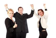 Mooie bedrijfsmensen die van haar succes genieten Stock Foto's