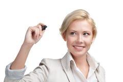 Mooie bedrijfsvrouw die op het onzichtbare scherm schrijven Stock Foto