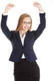 Mooie bedrijfsvrouw met haar omhoog handen. Zij heeft tevredengesteld. Stock Foto's