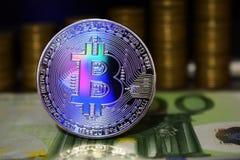 Mooie Bitcoin BTC op de achtergrond van euro bankbiljet en gouden muntstukken royalty-vrije stock afbeeldingen