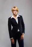 Mooie blonde jonge onderneemster stock foto's
