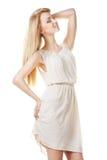 Mooie blonde vrouw met lang haar op wit Royalty-vrije Stock Foto's