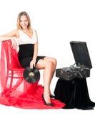 Mooie blondevrouw met grammofoon Stock Fotografie