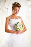 Mooie bruid met boeket van bloemen royalty-vrije stock foto's