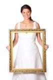 Mooie bruid met gouden frame Stock Fotografie