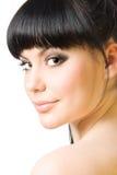 Mooie brunette die op wit wordt geïsoleerd Royalty-vrije Stock Afbeeldingen