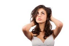 Mooie brunette die op witte achtergrond wordt geïsoleerds Royalty-vrije Stock Afbeeldingen