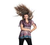 Mooie brunette met vliegend haar Stock Foto's