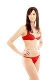 Mooie brunette in rood ondergoed Stock Foto