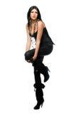 Mooie brunette in zwarte beenkappen. Geïsoleerd royalty-vrije stock foto's
