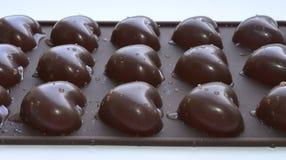 Mooie chocoladeharten met waterdalingen stock foto's