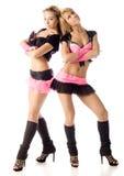 Mooie clubmeisjes die op wit stellen Stock Foto