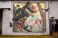 Mooie creatieve straatkunst van graffiti Karaktersverhalen, kunstenaar Dulk Stock Fotografie