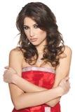 Mooie donkerbruine vrouw in rode kleding Royalty-vrije Stock Fotografie