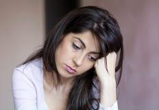 Mooie droevige jonge vrouw binnen stock foto's