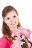 Mooie en gelukkige vrouw met bloemen Stock Afbeelding