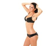 Mooie die vrouw in bikini op witte achtergrond wordt geïsoleerdb Stock Fotografie