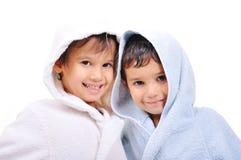 Mooie gelukkige kinderjaren in robe Stock Afbeeldingen